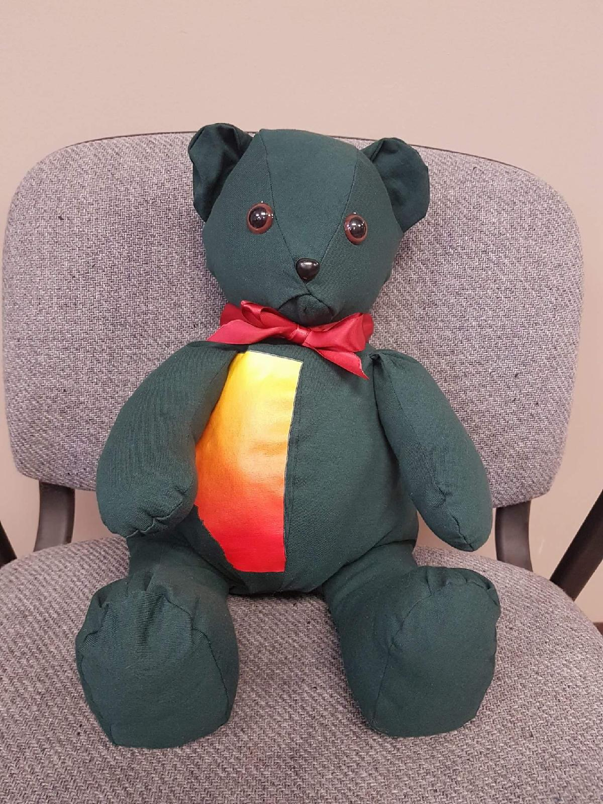 Heat Up Alberta Teddy Bear sitting in a chair